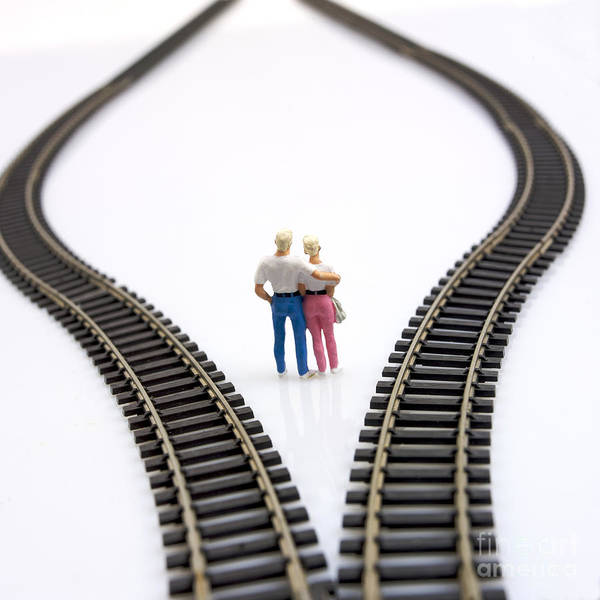 Unfocused Poster featuring the photograph Couple Two Figurines Between Two Tracks Leading Into Different Directions Symbolic Image For Making Decisions by Bernard Jaubert