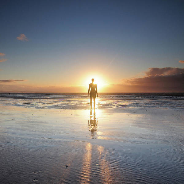 Adult Poster featuring the photograph Man Walking On Beach At Sunset by Stu Meech