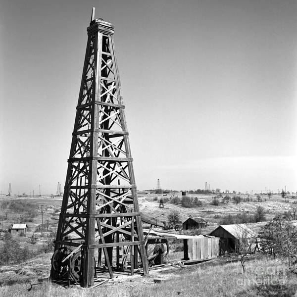 Oilfield Poster featuring the photograph Old Wooden Derrick by Larry Keahey