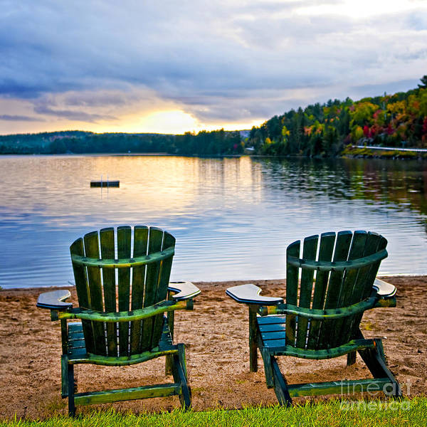 Lake Poster featuring the photograph Wooden Chairs At Sunset On Beach by Elena Elisseeva