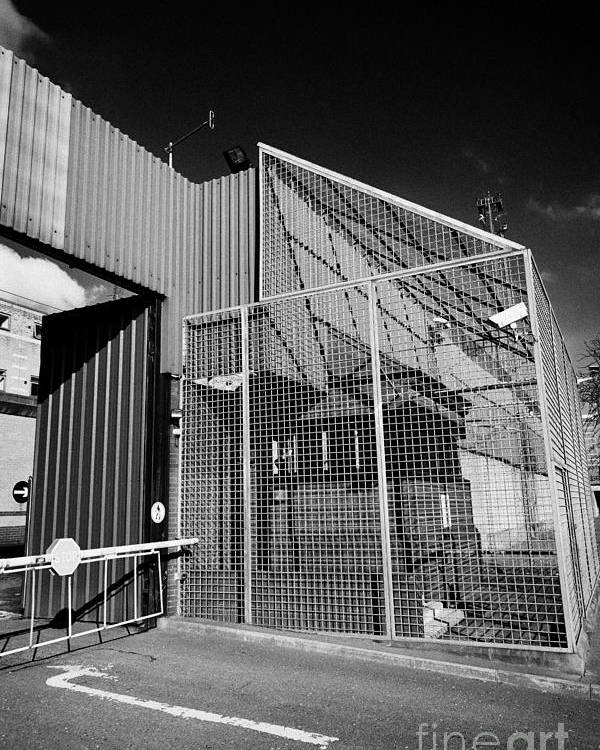 North Poster featuring the photograph anti rpg cage surrounding observation sanger at North Queen Street PSNI police station Belfast North by Joe Fox