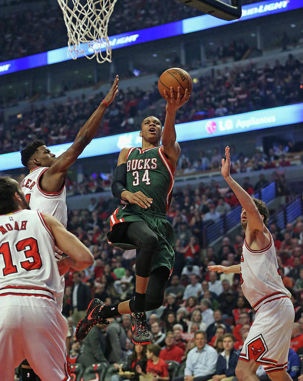 Playoffs Poster featuring the photograph Milwaukee Bucks V Chicago Bulls - Game by Jonathan Daniel