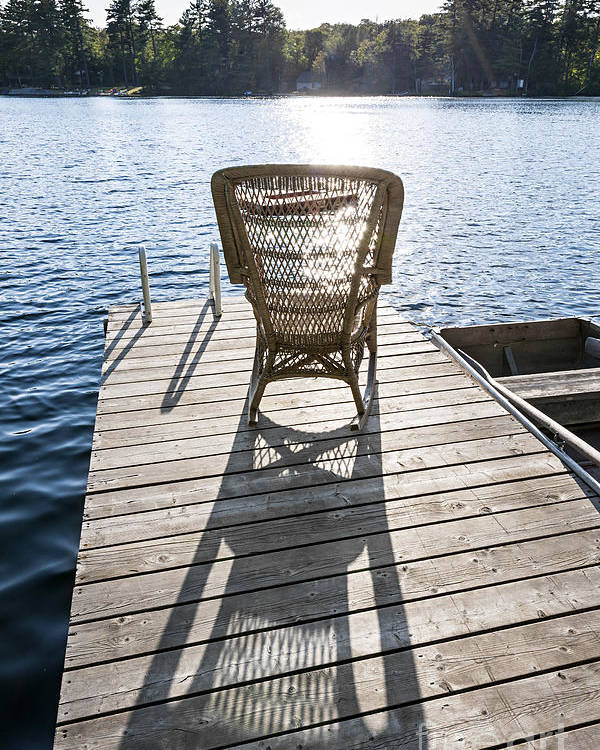 Rocking Chair Poster featuring the photograph Rocking Chair On Dock by Elena Elisseeva