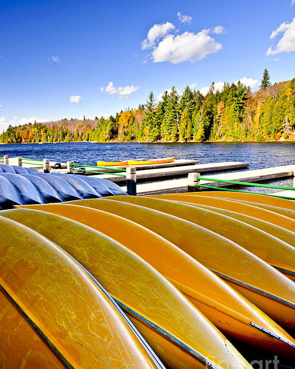 Canoes Poster featuring the photograph Canoes On Autumn Lake by Elena Elisseeva
