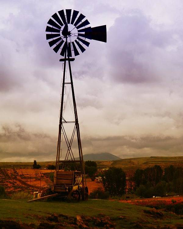 Farm Poster featuring the photograph A Windmill And Wagon by Jeff Swan