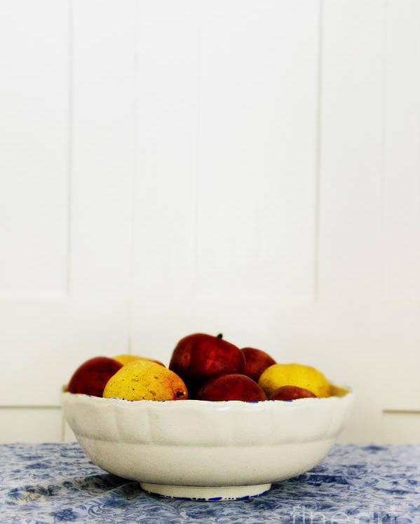 Fruit; Bowl; Still Life; Table; Table Cloth; Bowl Of Fruit; Fresh; Food; Kitchen; Old; Apples; Red; Yellow; Inside; Indoors; White; Blue; Minimal; Minimalism; Wall; Wood Poster featuring the photograph Apples by Margie Hurwich