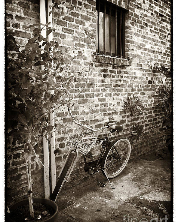 Bike In Pirates Alley Poster featuring the photograph Bike In Pirates Alley by John Rizzuto