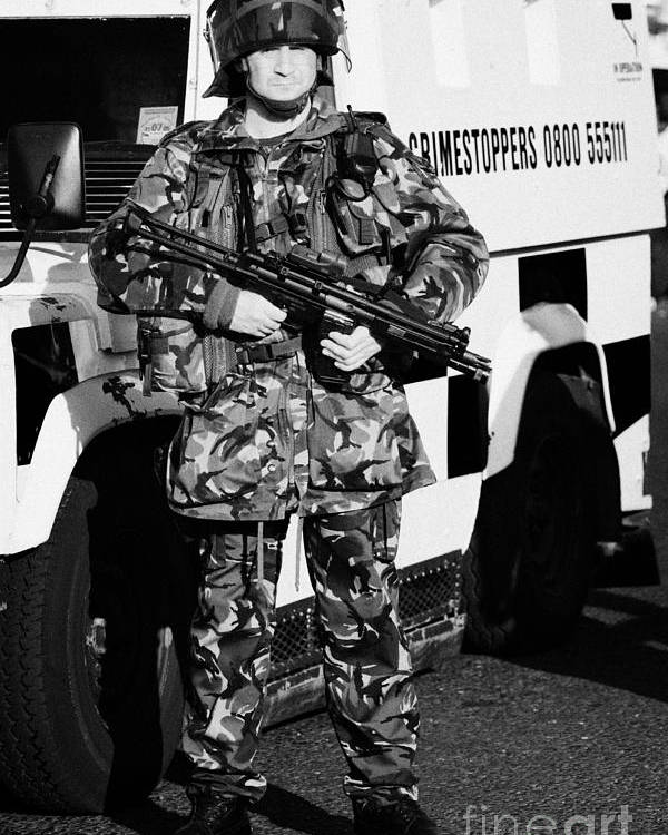 Northern Poster featuring the photograph British Army Soldier With Mp5 On Crumlin Road At Ardoyne Shops Belfast 12th July by Joe Fox