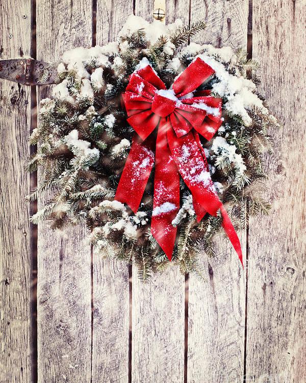 Christmas Poster featuring the photograph Christmas Wreath On Barn Door by Stephanie Frey