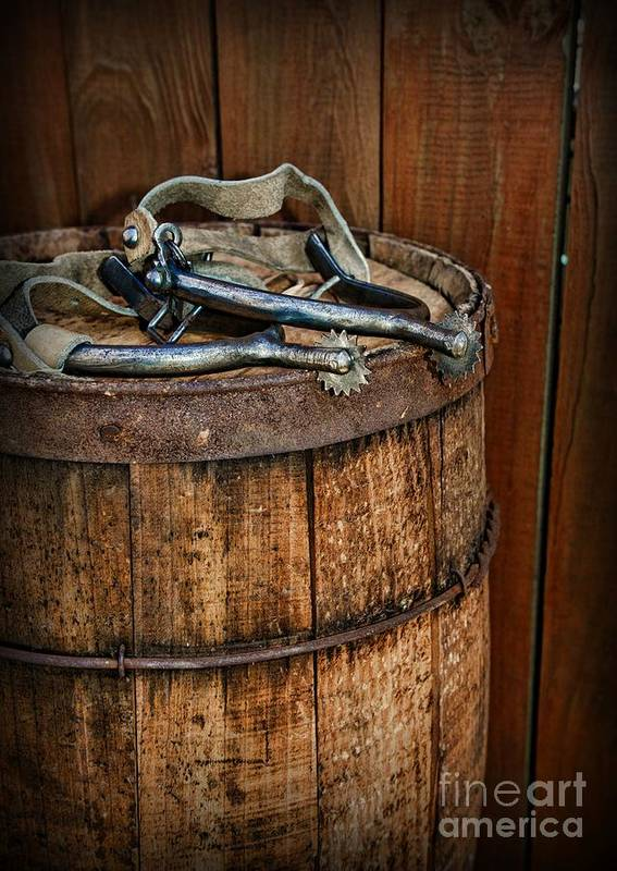 Barn Poster featuring the photograph Cowboy Spurs On Wooden Barrel by Paul Ward