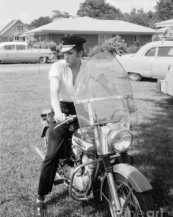 Elvis Presley Poster featuring the photograph Elvis Presley with his 1956 Harley KH and his Cadillacs by The Harrington Collection