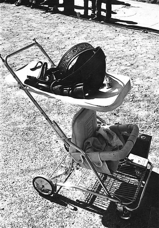 Holster Baby Carriage Helldorado Days Tombstone 1970 Black And White Brief Case Onlookers Poster featuring the photograph Holster Baby Carriage Helldorado Days Tombstone 1970 by David Lee Guss