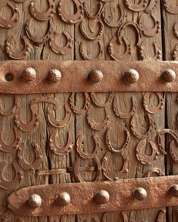 Architecture Poster featuring the photograph Horseshoes Decorate A Wooden Door, Jama by Inger Hogstrom
