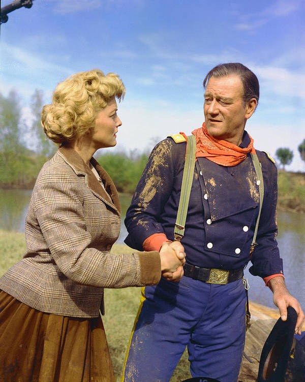 The Horse Soldiers Poster featuring the photograph John Wayne In The Horse Soldiers by Silver Screen