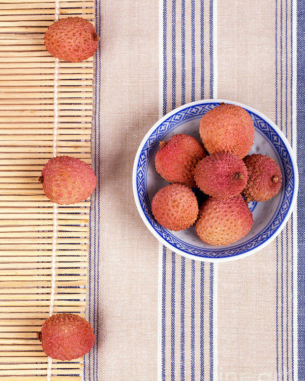 Fruit Poster featuring the photograph Lychess With Bamboo Mat by Jane Rix