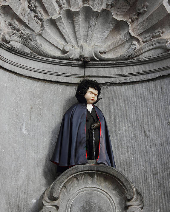 Pee Poster featuring the photograph Manneken Pis In Brussels Dressed As Dracula by Kiril Stanchev
