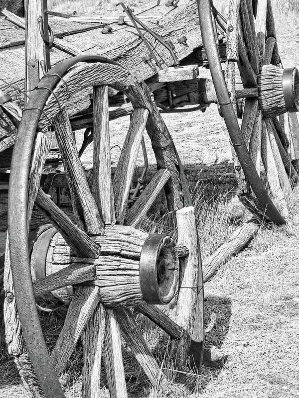 Wheel Poster featuring the photograph Montana Old Wagon Wheels Monochrome by Jennie Marie Schell
