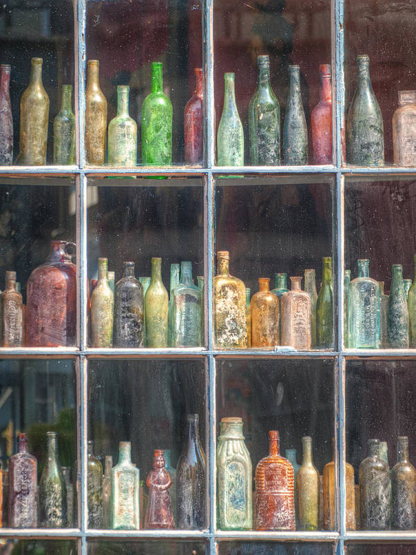 Bottles Poster featuring the photograph Old Glass by Brenda Bryant