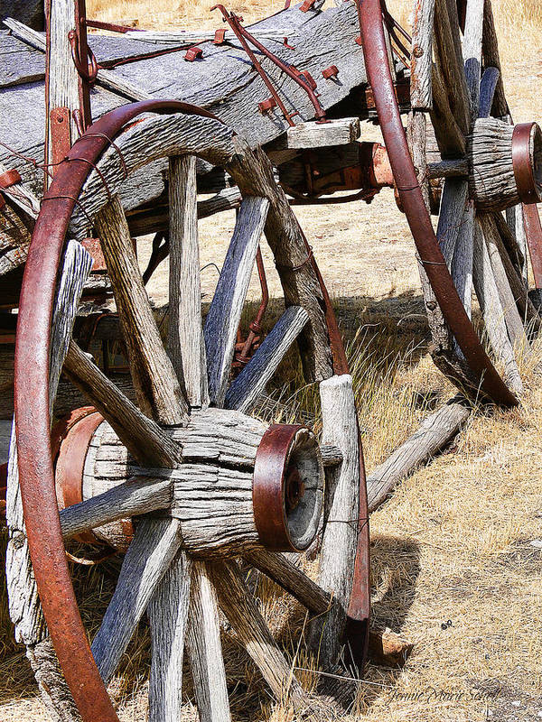 Wheel Poster featuring the photograph Old Wagon Wheels From Montana by Jennie Marie Schell