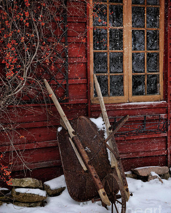 Atmosphere Poster featuring the photograph Old Wheelbarrow Leaning Against Barn In Winter by Sandra Cunningham