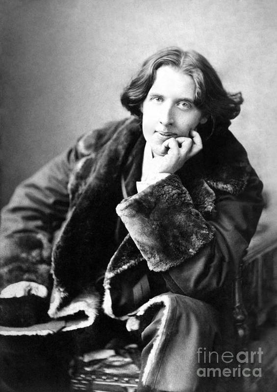 1900; Writer; Seated; Fur-trimmed Coat; Author; Oscar Wilde Poster featuring the photograph Oscar Wilde In His Favourite Coat 1882 by Napoleon Sarony