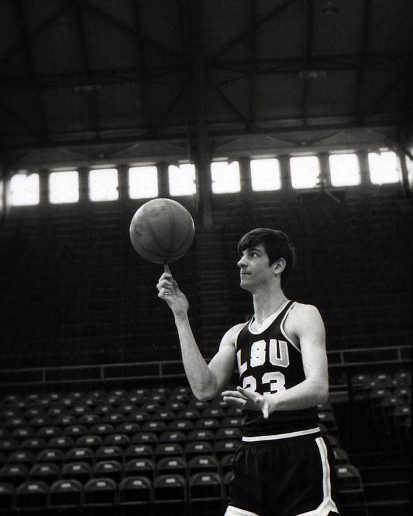 Classic Poster featuring the photograph Pete Maravich Spinning Ball On Finger by Retro Images Archive