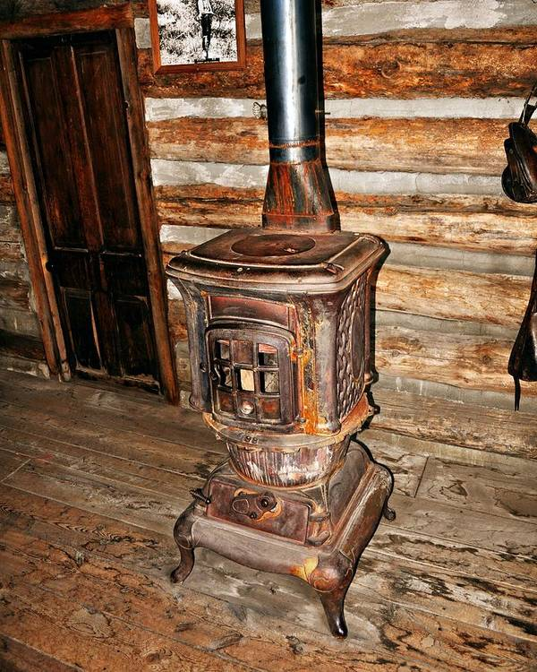 Rustic Poster featuring the photograph Potbelly Stove by Marty Koch