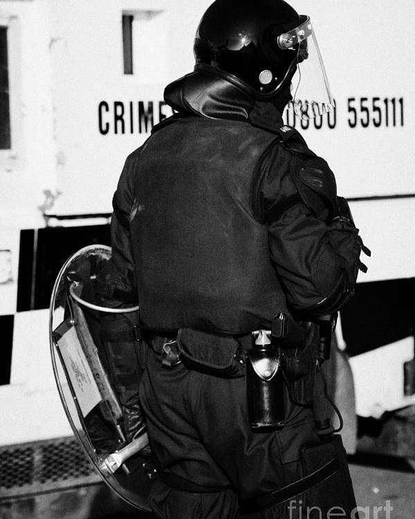 Northern Poster featuring the photograph Psni Officer With Riot Gear On Crumlin Road At Ardoyne Shops Belfast 12th July by Joe Fox