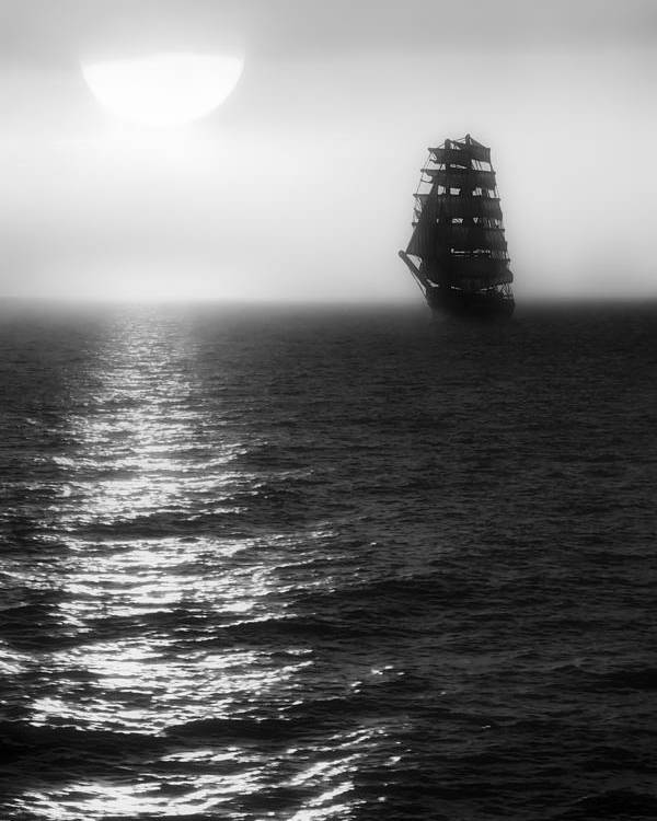 Sailing Ship Poster featuring the photograph Sailing Out Of The Fog - Black And White by Jason Politte