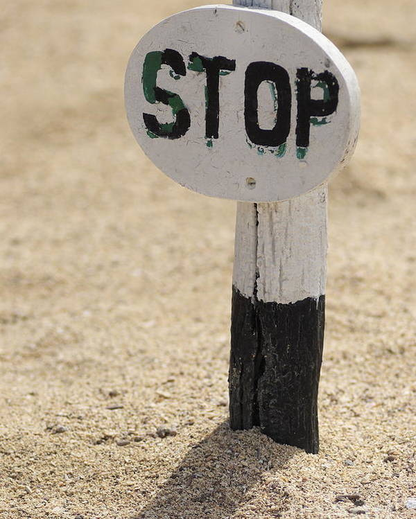 Authority Poster featuring the photograph Stop Sign On Sand by Sami Sarkis