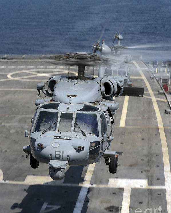 Military Poster featuring the photograph Two Mh-60s Sea Hawk Helicopters Take by Stocktrek Images