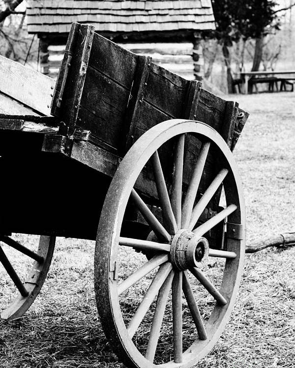Black And White Poster featuring the photograph Wagon Wheel by Erin Johnson