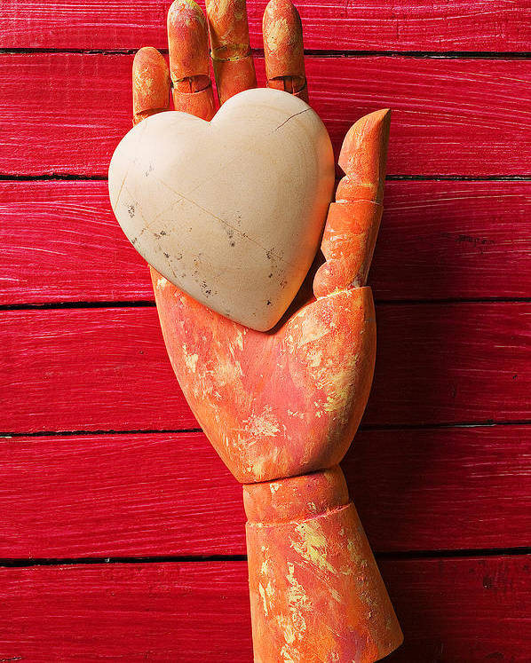 Heart Poster featuring the photograph Wooden Hand With White Heart by Garry Gay