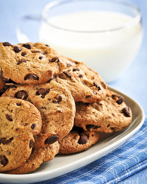 Cookies Poster featuring the photograph Chocolate Chip Cookies And Milk by Elena Elisseeva