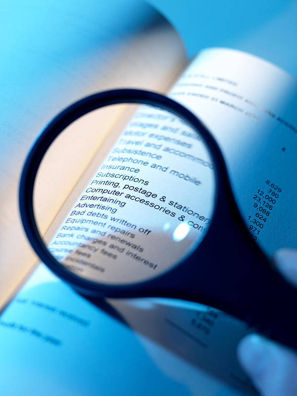 Magnifying Glass Poster featuring the photograph Financial Paperwork by Tek Image