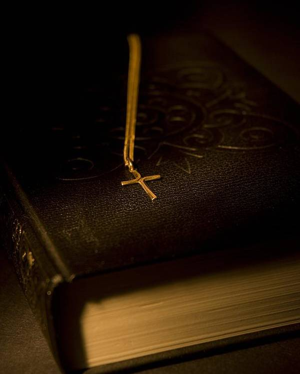 Bibles Poster featuring the photograph Gold Cross Pendant Resting On A Book by Philippe Widling