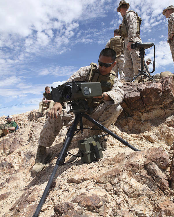 Chocolate Mountains Poster featuring the photograph A Marine Sets Up A Laser Designator by Stocktrek Images