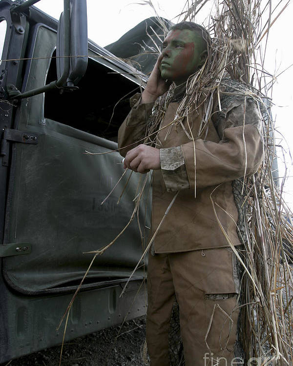 One Person Poster featuring the photograph A Scout Observer Applies Camouflage by Stocktrek Images