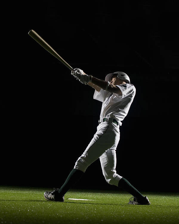 25-29 Years Poster featuring the photograph Baseball Batter Swinging Bat, Side View by PM Images