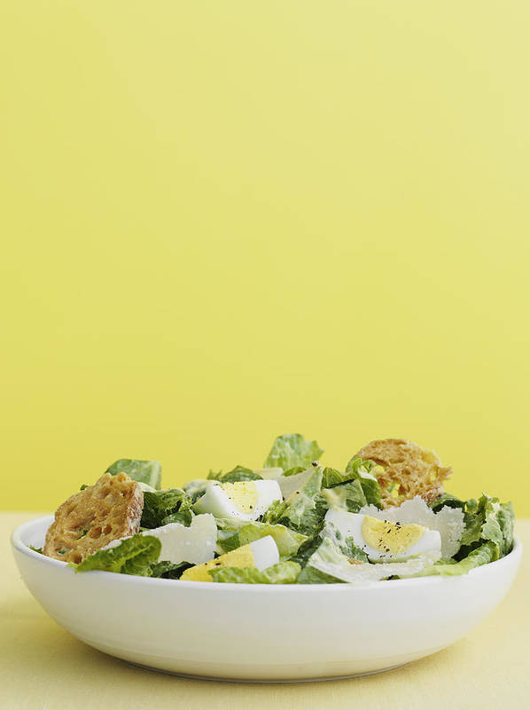 Vertical Poster featuring the photograph Bowl Of Caesar Salad With Egg by Cultura/BRETT STEVENS