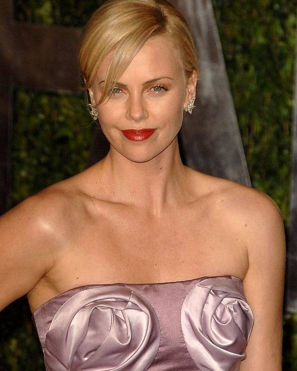Charlize Theron Poster featuring the photograph Charlize Theron Wearing A Dior Haute by Everett