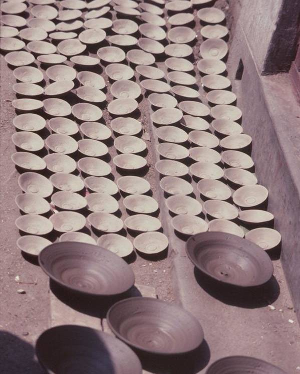 Hand-thrown Pottery Poster featuring the photograph Clay Yogurt Cups Drying In The Sun by David Sherman