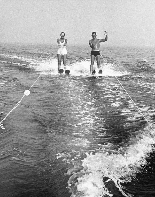 Adult Poster featuring the photograph Couple Water Skiing by George Marks