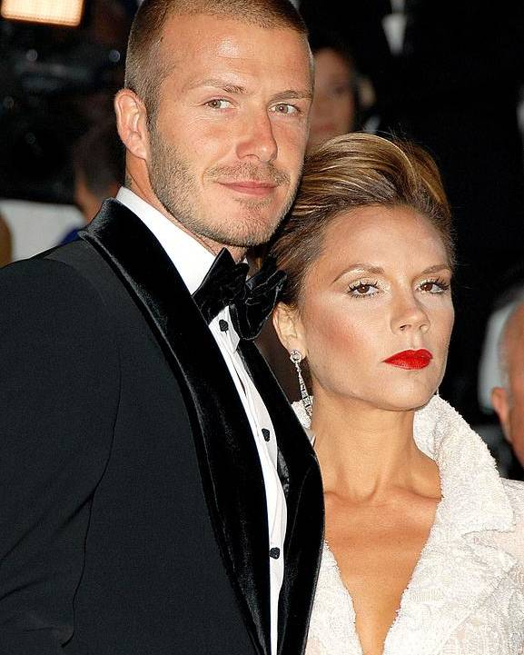 Annual Opening Night Gala Of Superheroes Fashion And Fantasy Poster featuring the photograph David Beckham And Victoria Beckham by Everett