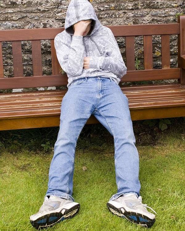 Bench Poster featuring the photograph Depressed Teenage Boy On Park Bench. by Mark Williamson