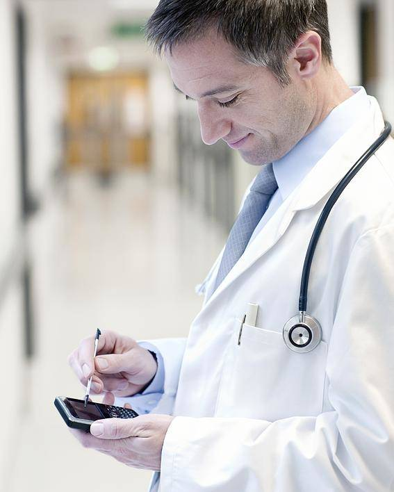 Telephone Poster featuring the photograph Doctor Using A Smart Phone by