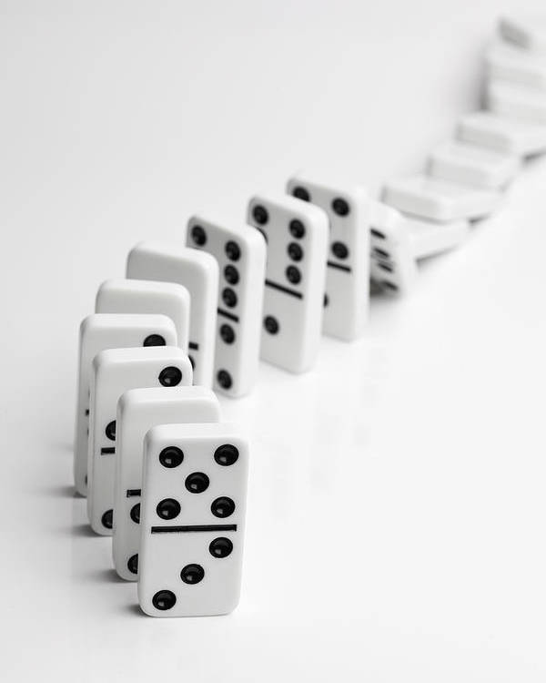 Vertical Poster featuring the photograph Dominoes Falling Over In A Chain Reaction by Larry Washburn