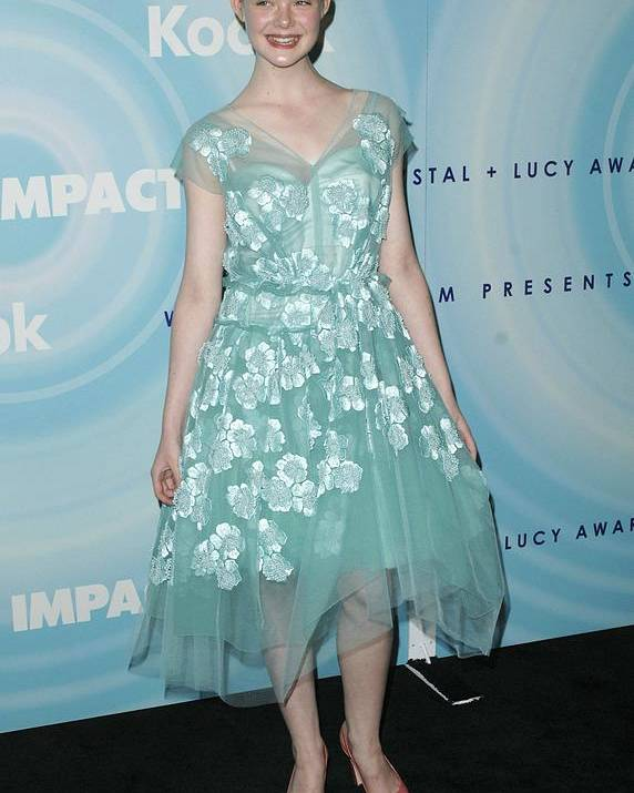 Elle Fanning Poster featuring the photograph Elle Fanning Wearing A Dress By Marc by Everett
