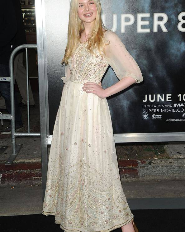 Elle Fanning Poster featuring the photograph Elle Fanning Wearing A Vintage Dress by Everett
