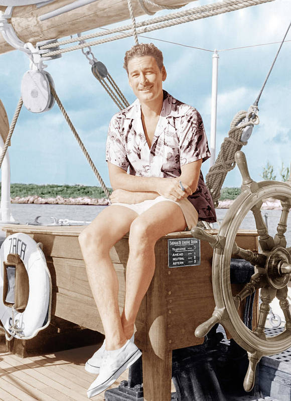 1940s Candid Poster featuring the photograph Errol Flynn Relaxing On His Yacht, Ca by Everett